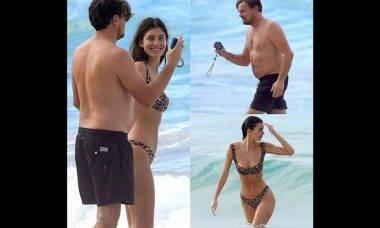 Namorada ganha mão boba de Leonardo DiCaprio em dia de praia antes do Globo de Ouro