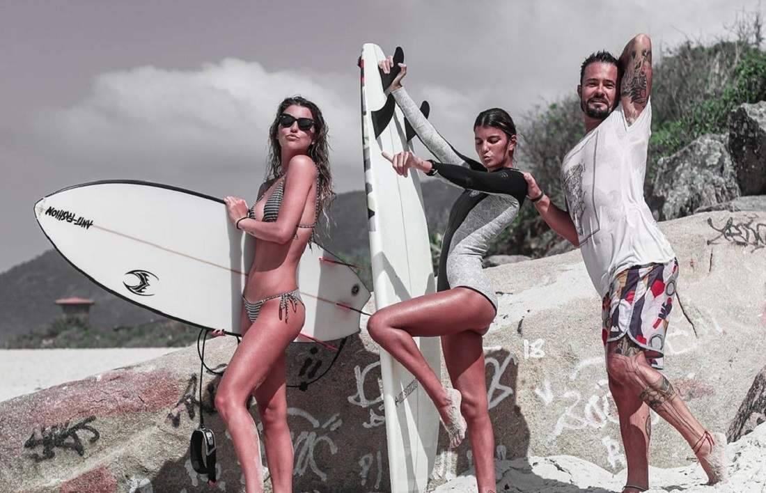 Paulo Vilhena curte dia de praia e muito surfe com namorada e a cunhada gêmea