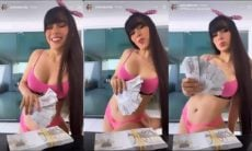 Juliano Caetano causa na web se abanando com notas de 200 reais usando apenas um biquíni rosa. Foto: Reprodução / Instagram
