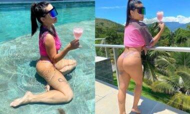 De biquíni rosa, Cleo Pires curte o calor carioca com drink e piscina